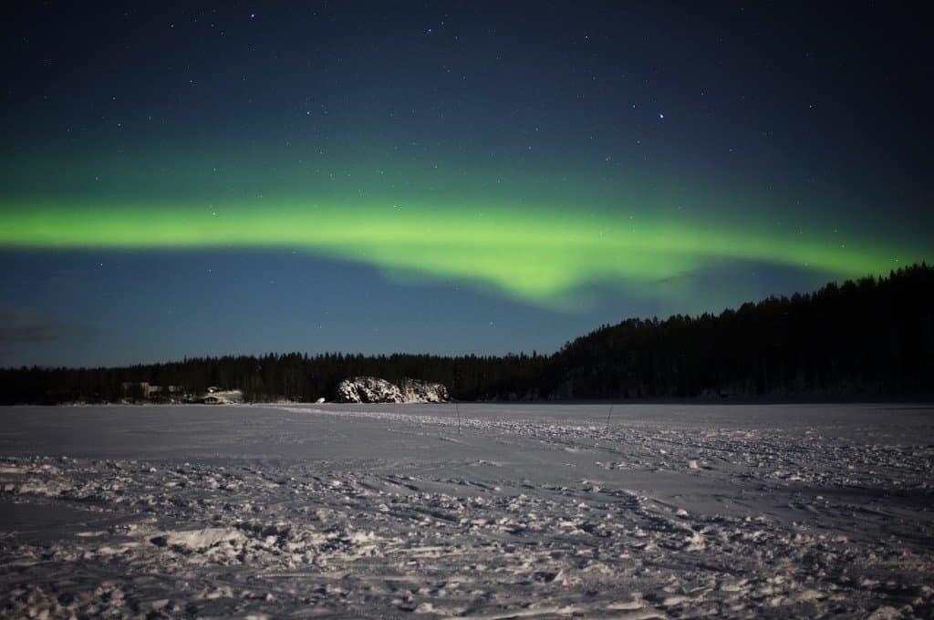 Frozen lake northen lights Finland