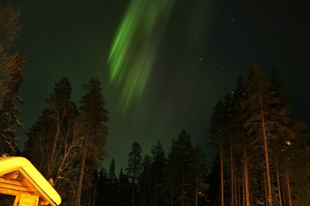 Hut and Northern Lights Finnish Lapland