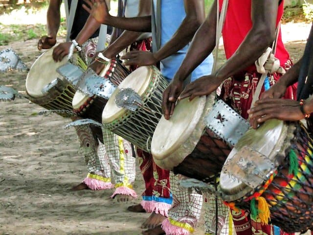 A group drumming in Gambia