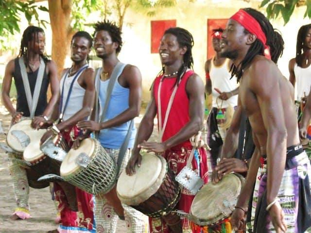 Good looking men in Gambia drumming