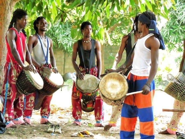 Men in drumming in Gambia