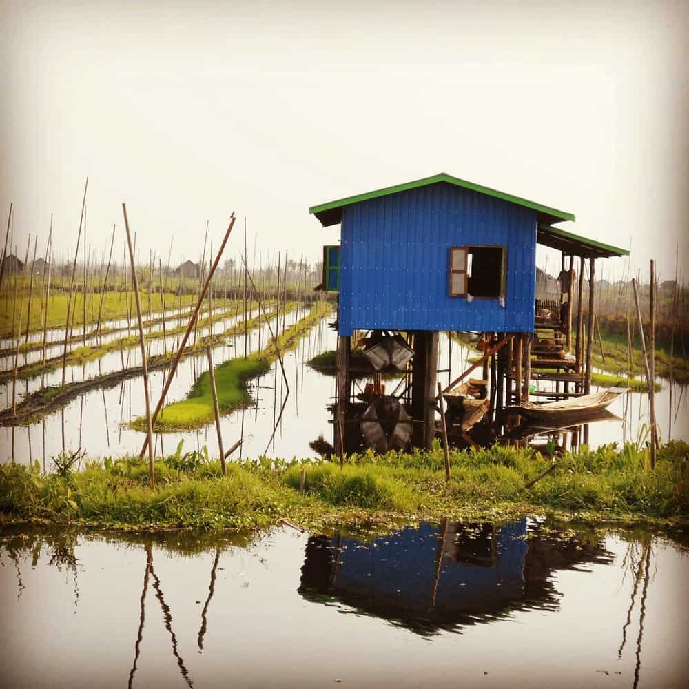 A wooden hut over water in Burma